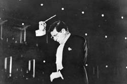 "Herrmann conducting the London Symphony Orchestra and singers during the Royal Albert Hall scenes of ""The Man Who Knew Too Much"""