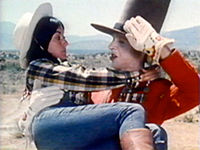 Chuck Menville as Sgt. Swell with Kathy Puerta as Emmy Lou