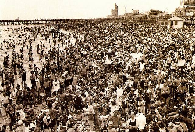 People flocking to the beach at Coney Island, ca. 1935.
